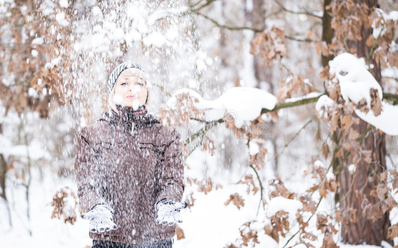 Download Girl tosses snow up. stock photo. Image of happiness - 83709184