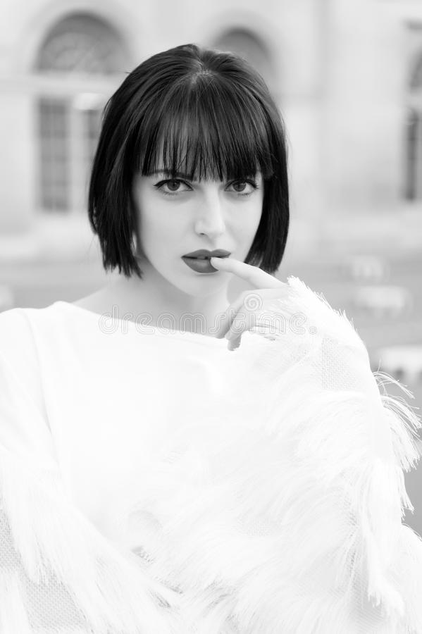 Girl touch red lips with finger in paris, france stock photos