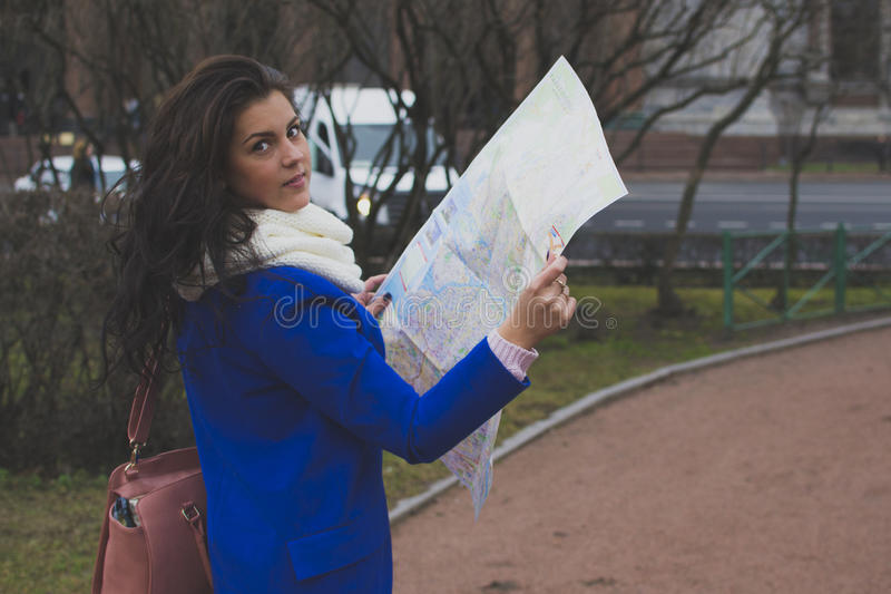 The girl tourist with map. stock photo
