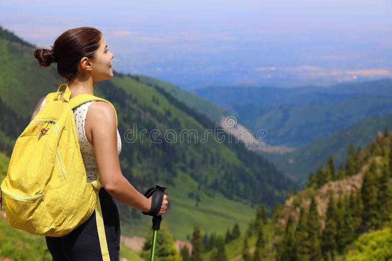 Girl tourist standing in the mountains stock photography
