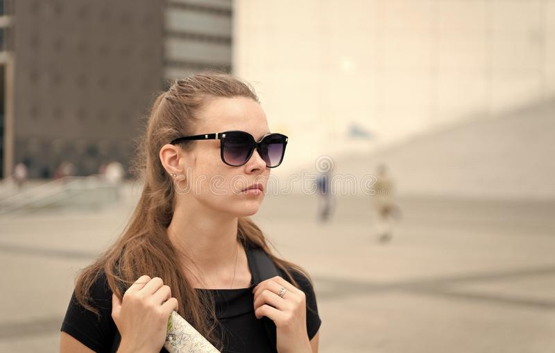 Girl tourist sunglasses enjoy view paris square city center. Woman stand in front of urban architecture copy space. Must stock photography