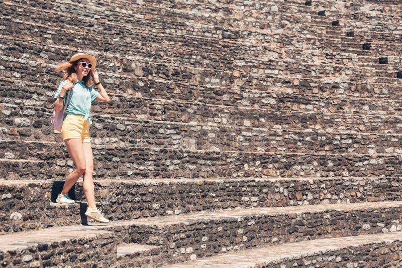 Tourist walking in ancient roman or greek ruines of antique amphitheater. Girl tourist walking in ancient roman or greek ruines of antique amphitheater stock image