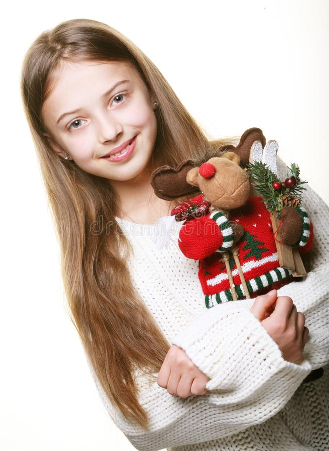Girl with toy deer. Happy girl with toy deer royalty free stock photo