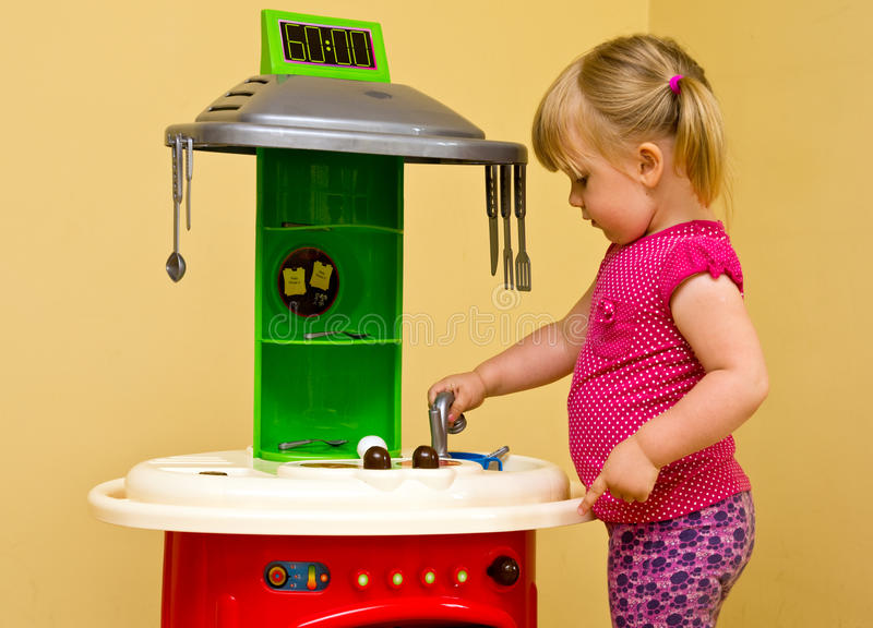 Download Girl and toy kitchen stock photo. Image of playroom, home - 26403084