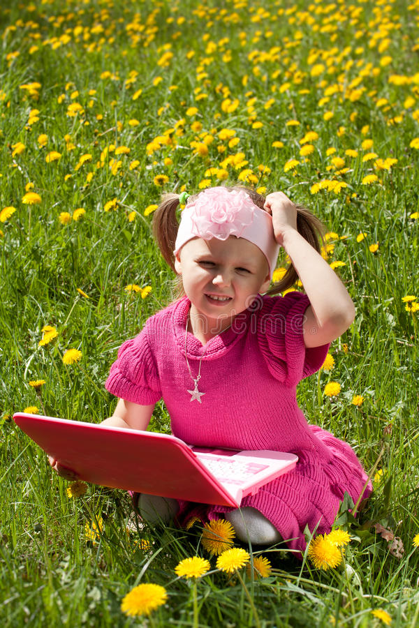 Girl With Toy Laptop Royalty Free Stock Photography