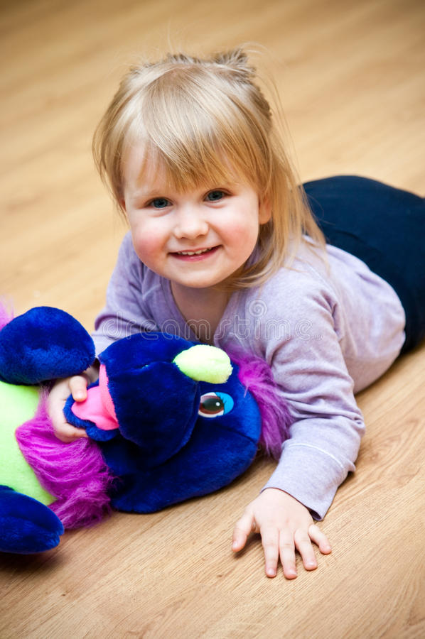 Download Girl With Toy Pet Stock Image - Image: 24118321
