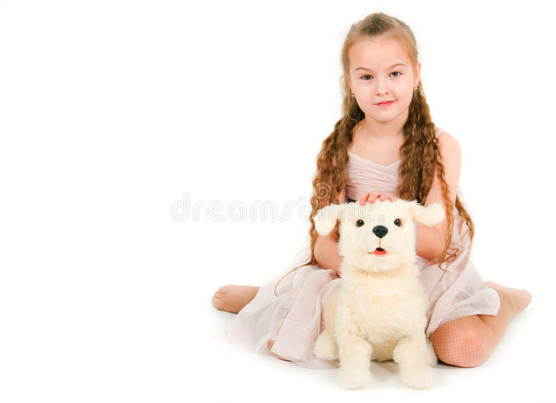 Download The girl with a toy puppy stock image. Image of years - 31225355