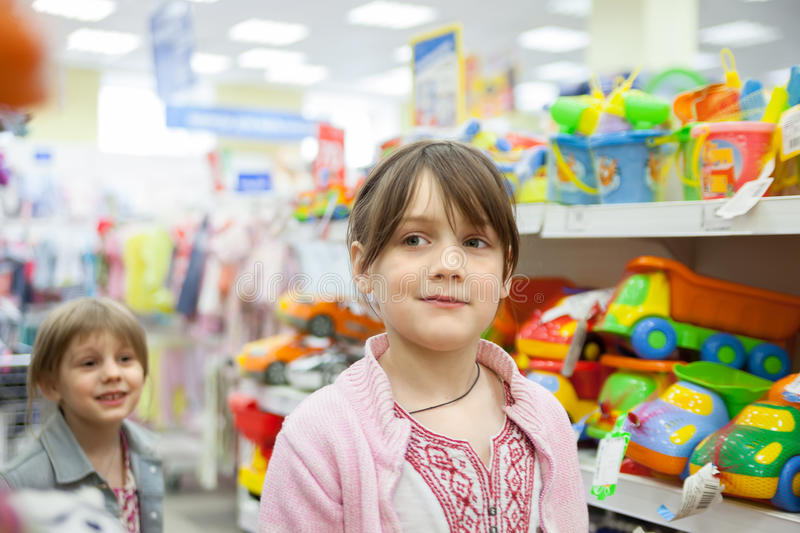 Girl In Toy Store Choosing Toys Stock Photo