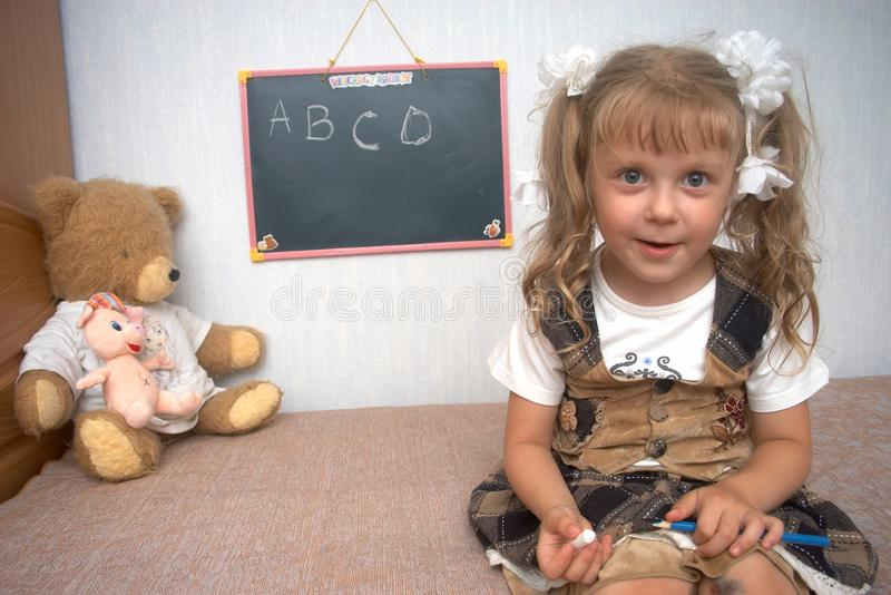 Girl with toys stock photography
