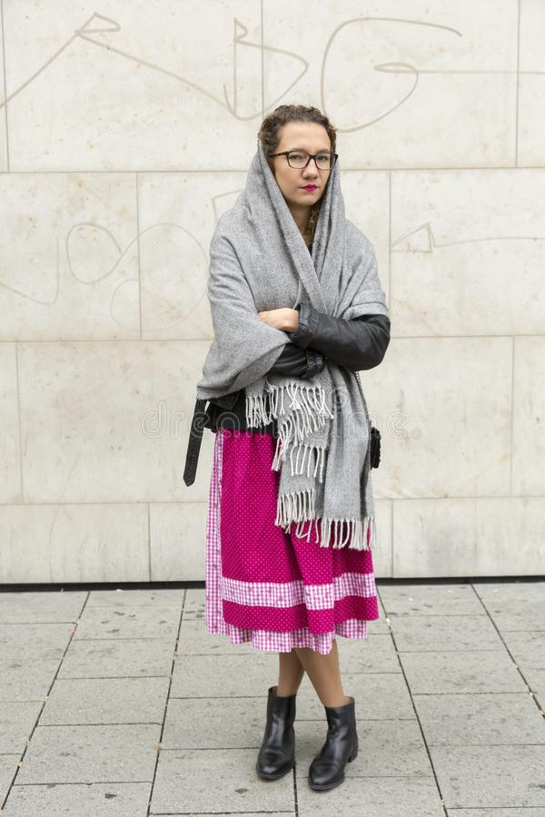 Girl goes to Oktober fest. Girl with traditional Bawarian skirt  goes to Oktober fest in Munich royalty free stock photo
