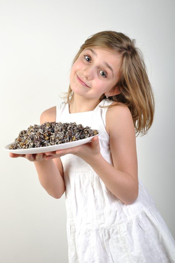Girl with traditional Christmas food kutia stock image