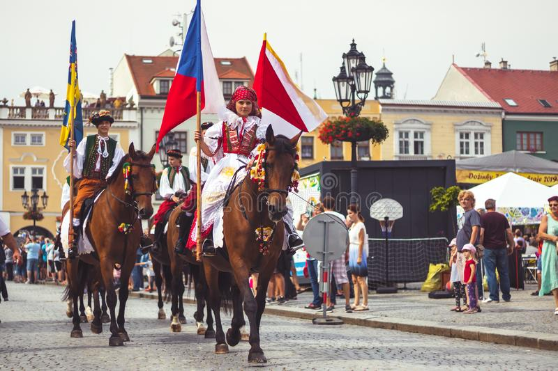 Girl in traditional costume with flag rides a horse stock images