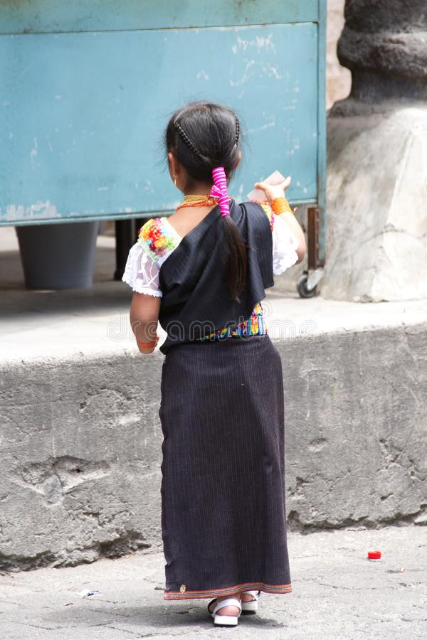 Indigenous girl in Cotacachi. Girl in traditional dress on Day of the Dead in Cotacachi, Ecuador royalty free stock images