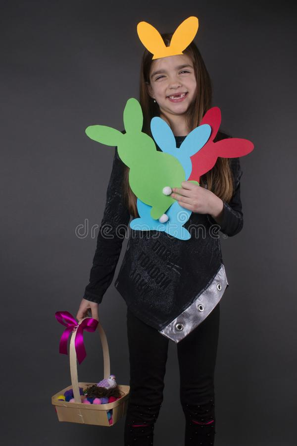 Girl traditional easter bunnies and ears stock photography