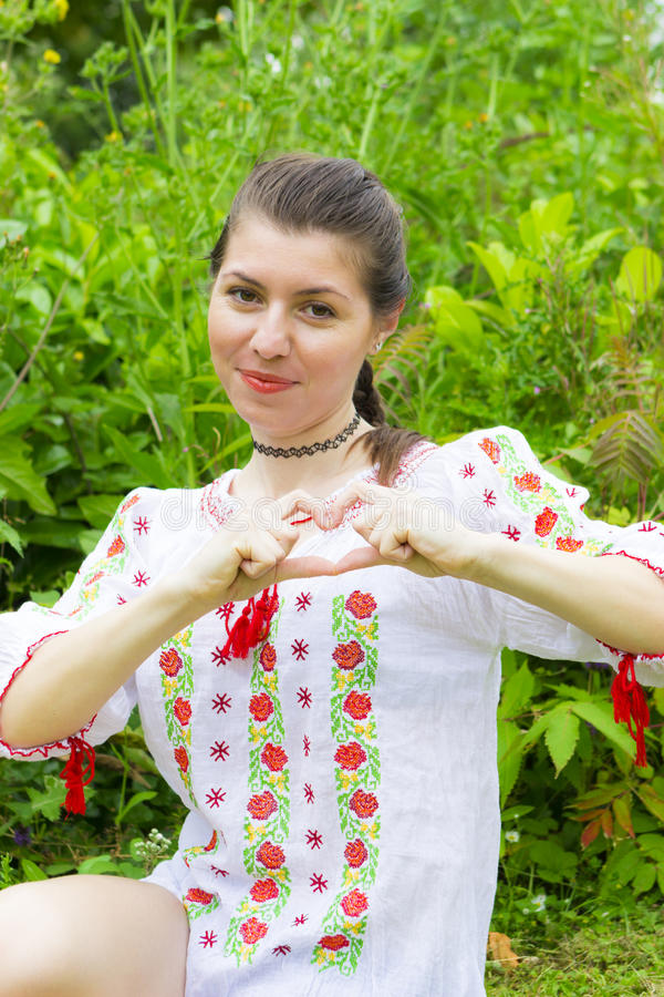 Girl in traditional Romanian blouse stock photography