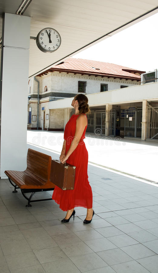 Girl at the train station royalty free stock photography