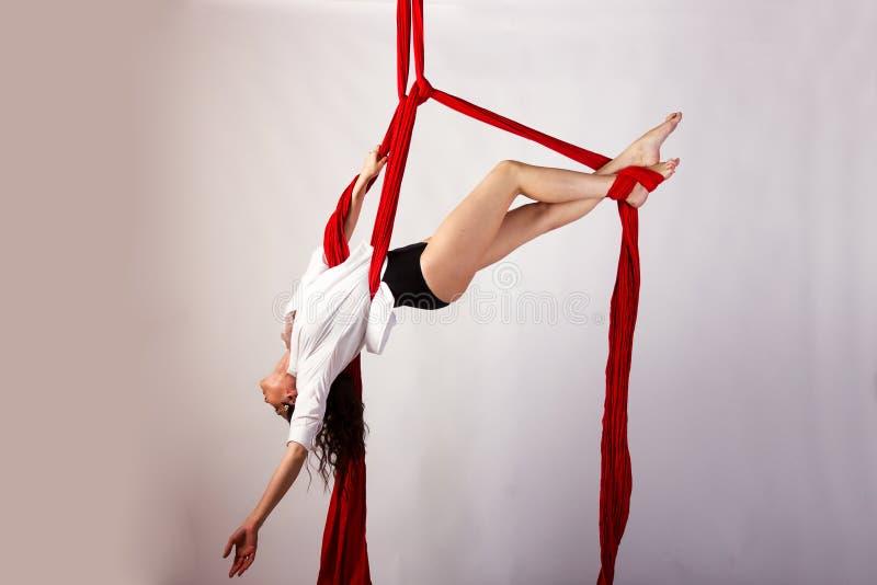 Girl training on aerial silks stock photo