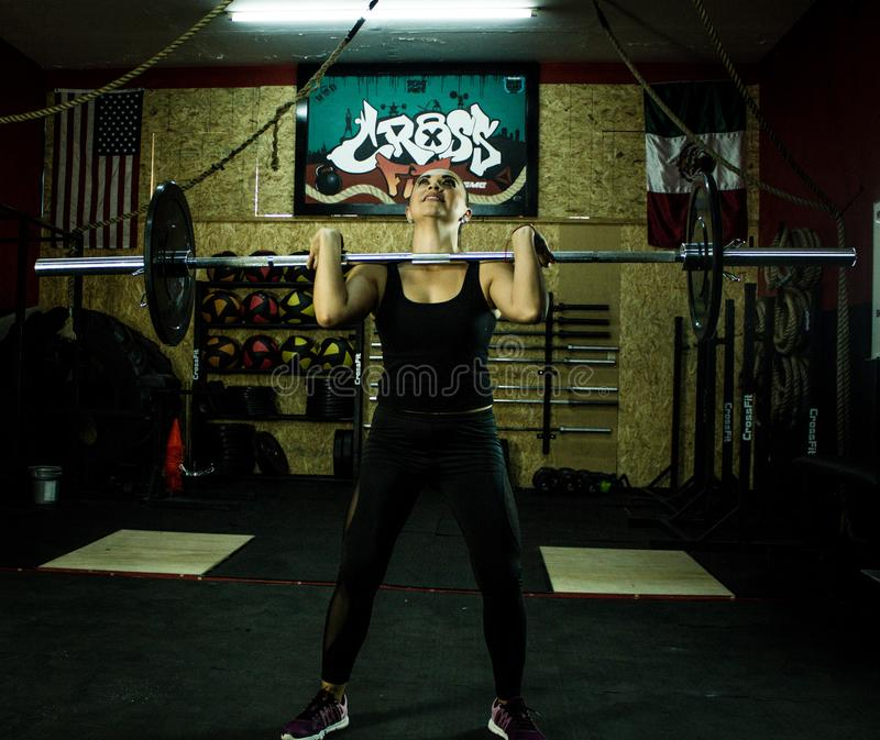 Crossfitter training hard daily wod lifting stock photography