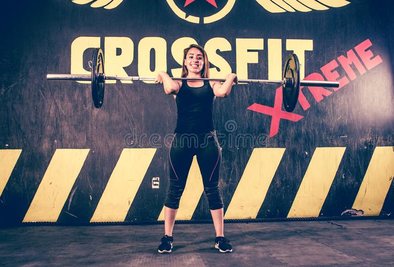 Crossfitter training hard daily wod pose royalty free stock image