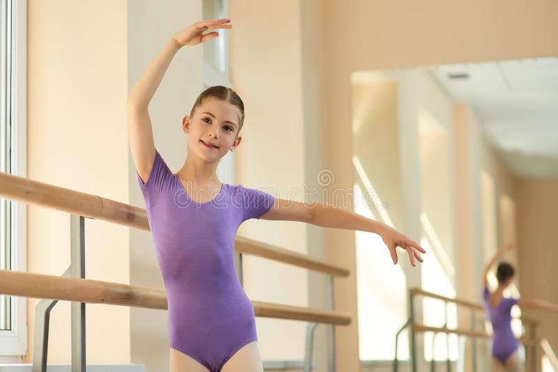 Girl training at professional ballet school. royalty free stock photos