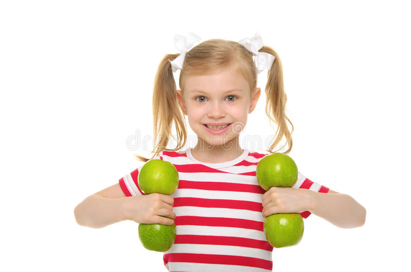 Girl trains fitness dumbbells from apples royalty free stock photography