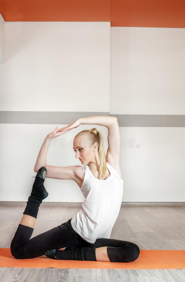 Girl trains in the gym. The concept of sport, dance and a health stock photo