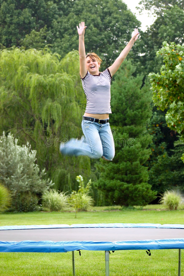Girl on Trampoline royalty free stock photos