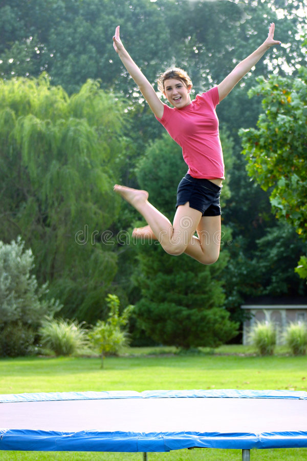 Girl on Trampoline stock images