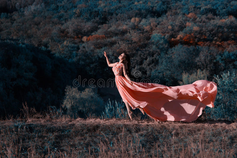 The girl in transparent pink dress stock photo