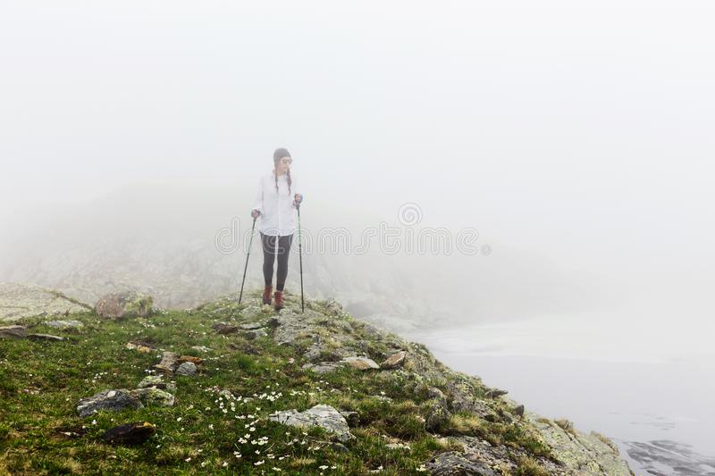 Girl hipster travels rocky mountains. royalty free stock images