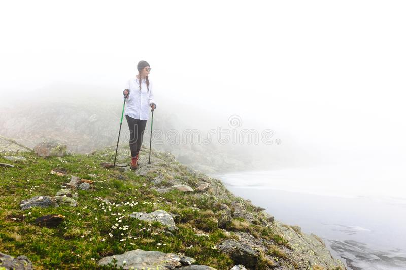 Girl hipster travels rocky mountains. stock photos