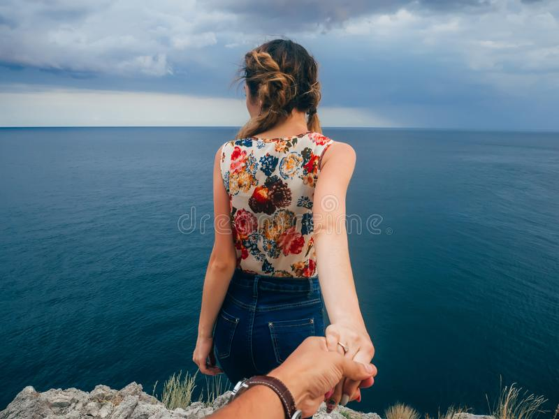 Girl traveler keeps your boyfriend on the holiday by the sea stock photo