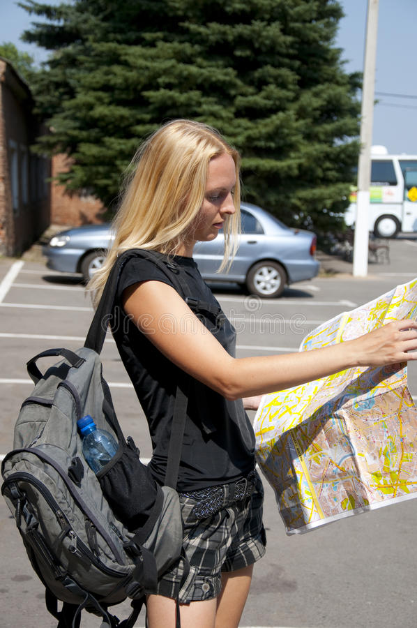 Download The Girl-traveller With A Map Royalty Free Stock Photos - Image: 15316838
