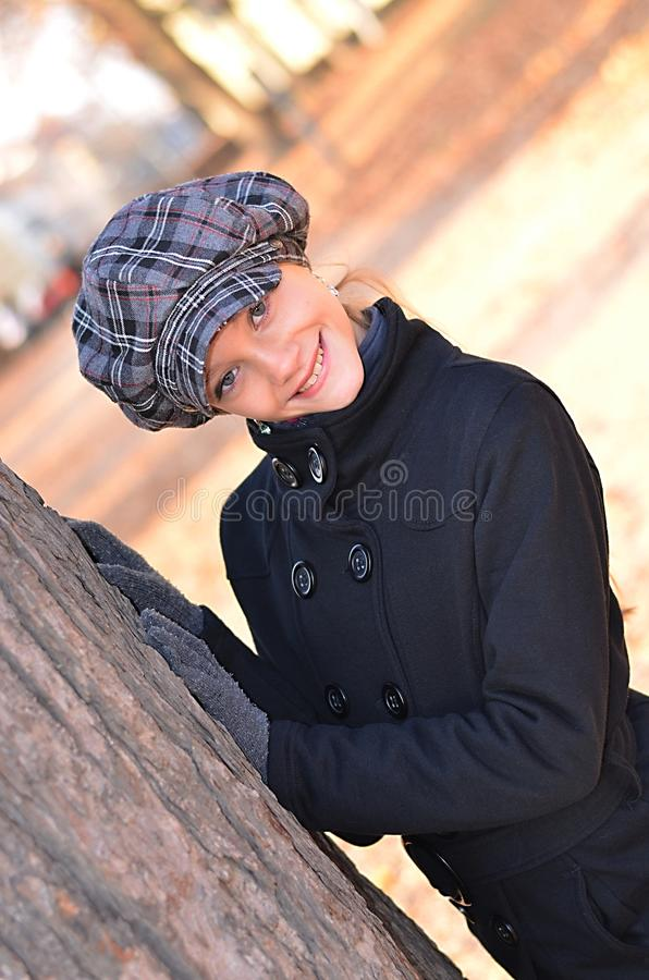 Girl and tree in autumn royalty free stock photography