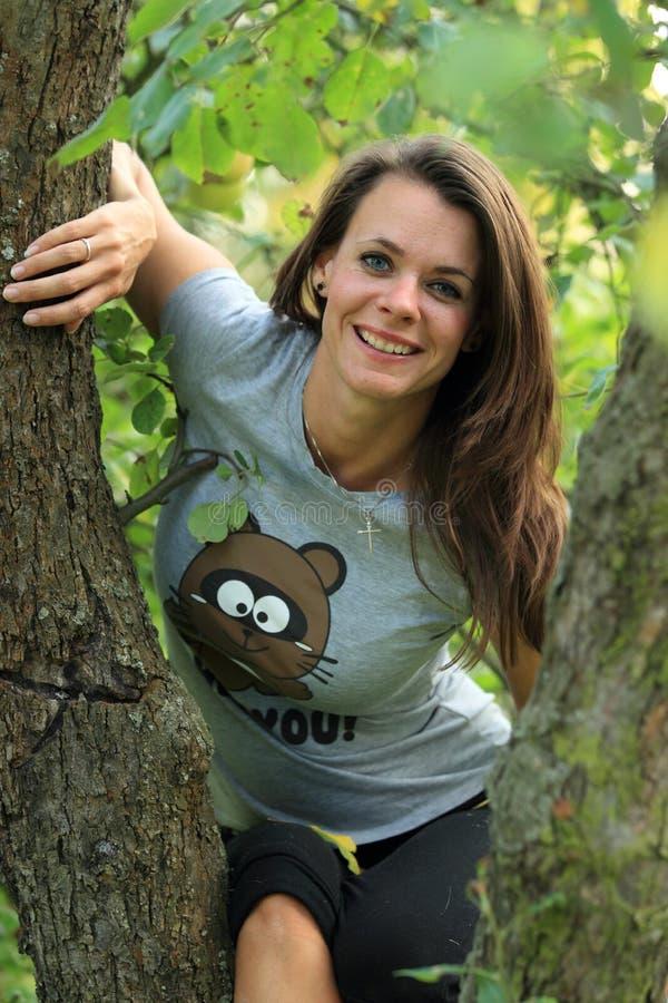 Girl on tree stock photo