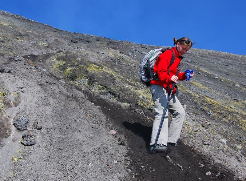 Girl trekking on Etna volcano royalty free stock images