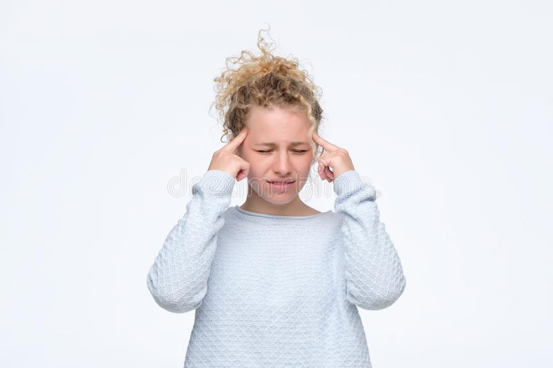 Girl tries to remember something in mind or generate idea. Thoughtful focused curly girl tries to remember something in mind or generate idea. Beautiful pensive stock photo