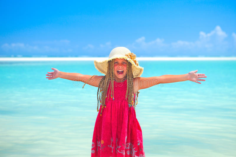 Girl at tropical beach happy stock image