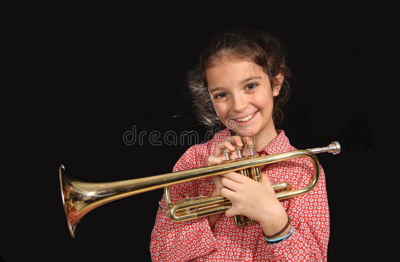 Girl with trumpet royalty free stock photos