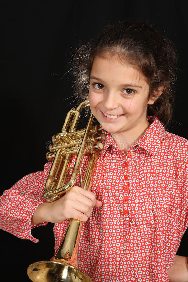 Girl with trumpet royalty free stock photo