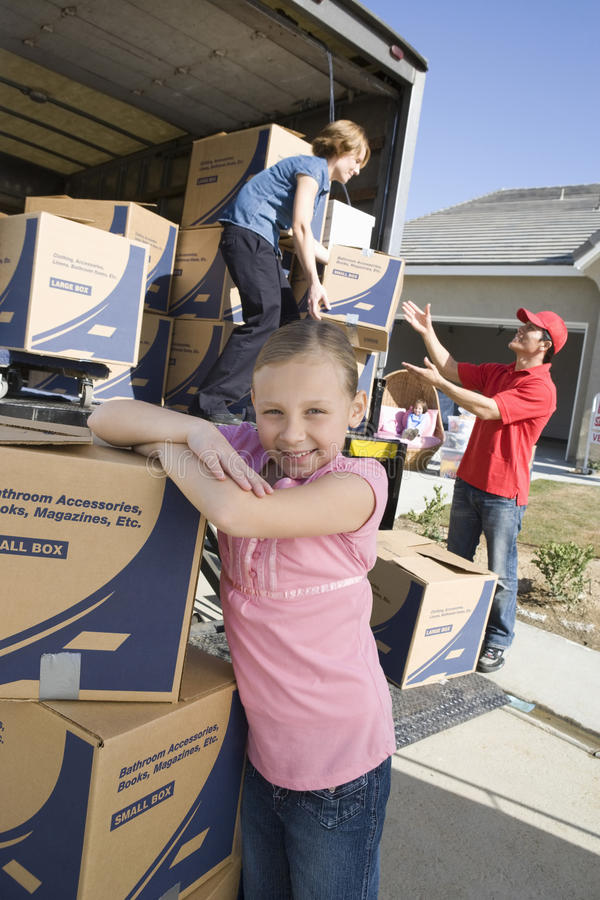 Girl By Trunk Of Cardboard Boxes stock photo