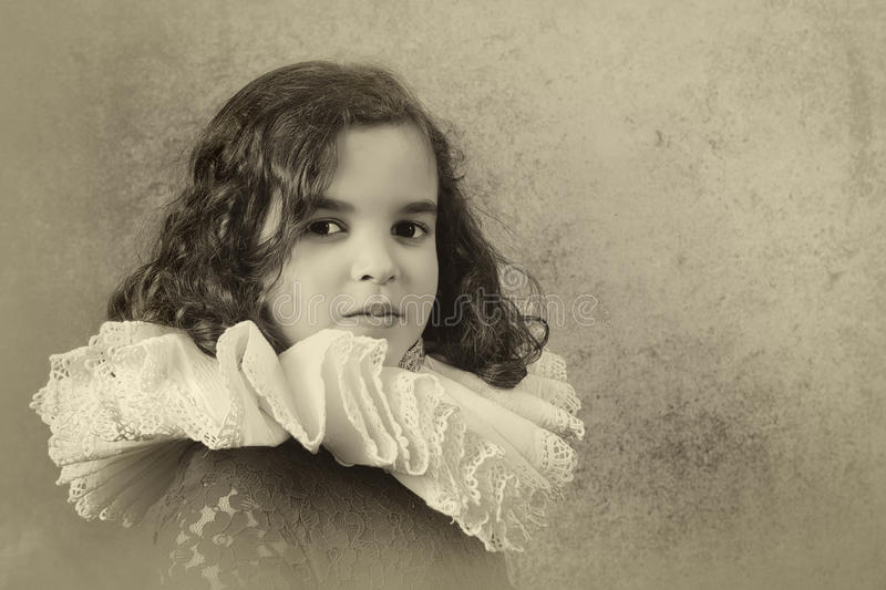 Girl with tudor ruff collar. Sweet victorian girl posing in the old style with a ruff collar stock image