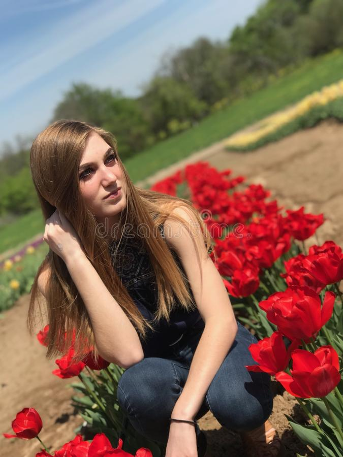 Young girl in tulip field stock photo