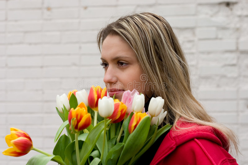 Girl With Tulips Royalty Free Stock Photography