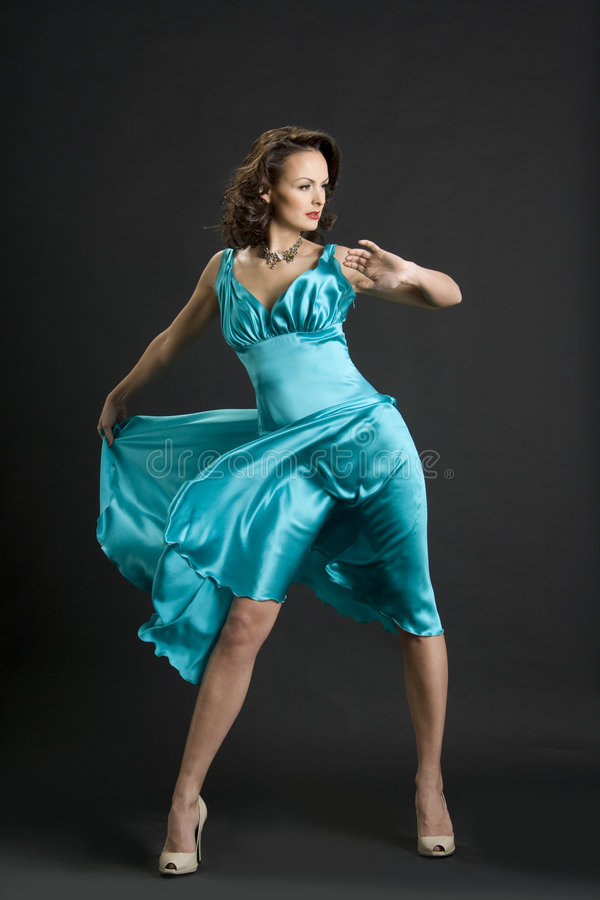 The girl in the turquoise dress stock photos