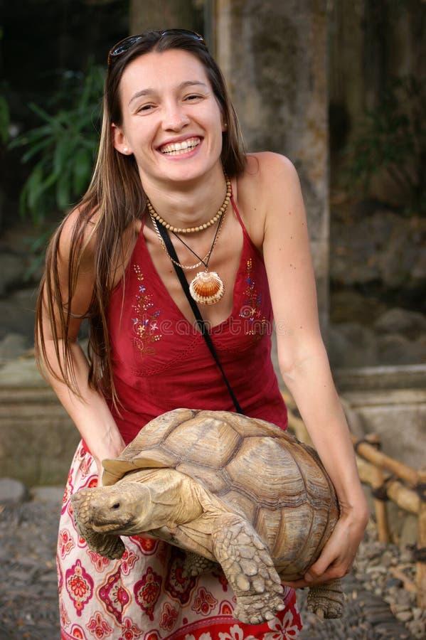 Girl with turtle stock image