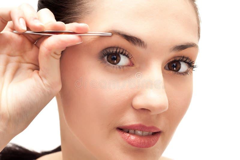 Girl, tweezers treatment stock image
