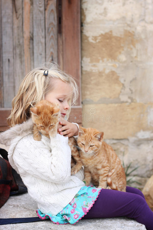 Girl with two kittens royalty free stock photos
