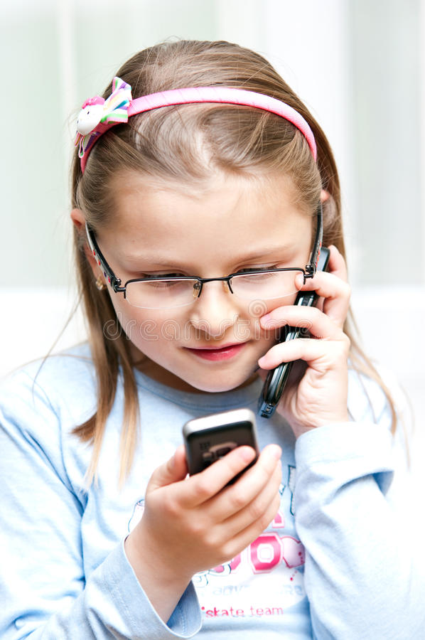 Girl with two mobile phones royalty free stock photos