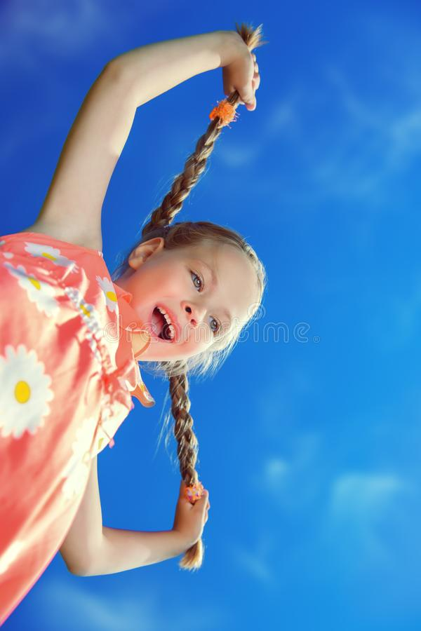Girl with two pigtails stock photography